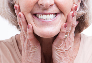 A woman smiling after receiving dental implants at Neil Starr, DDS, PC in Washington, DC