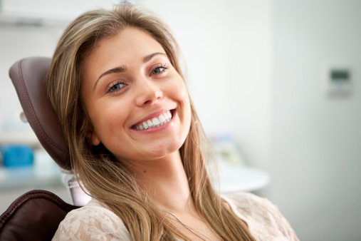 A woman smiling after receiving a gum lift at Neil Starr, DDS, PC in Washington, DC