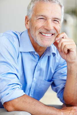 A man smiling after receiving prosthodontics care at Neil Starr, DDS, PC in Washington, DC